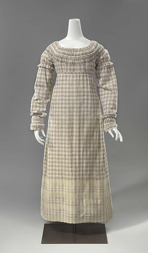 Although fairly plain, this chequered cotton gown is nevertheless lavishly decorated. Around the neck and cuffs are gathered strips of fabric and twisted cotton cords. The skirt consists of four broad panels, each with a drawstring inside a narrow casing. This dress was supposedly worn by the wife of a mayor in Zeeland during Napoleon's lightening visit to this province in 1811. Origin: Zeeland. Date: c 1811 – c 1815. Object ID: BK-1983-44.