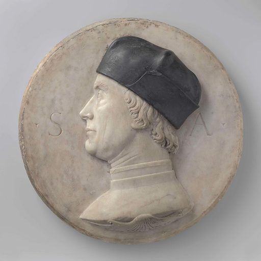 Neither the maker of this medallion nor the person portrayed is known with certainty, even though the subject's initials 'SA' appear in the background. With its sober style, this circular portrait resembles an ancient Roman coin. The use of two types of marble is unusual. Date: c 1500. Object ID: BK-17230.