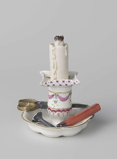 This chamber candlestick looks as though it belongs on an 18th-century table. A stick of red sealing wax, a seal and pair of scissors, possibly for trimming the wick of the candle, are ready for use. However, this candle could never actually be lit. All of these objects are made of Ansbach porcelain and were very realistically decorated in The Hague. Origin: The Hague. Date: c 1777 – c 1790. Object ID: BK-14563-B.