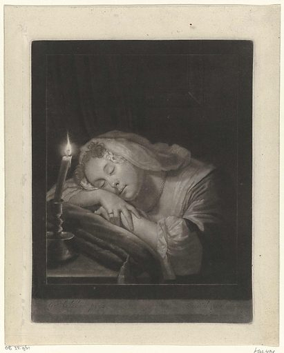 Sleeping young woman next to a candle
