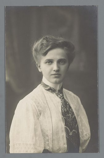 Portrait of an unknown young woman with a tie