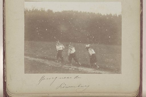 Three Vermeulen children in sailor suits walking on a sandy path. Origin: Germany. Date: c 1900 – c 1925. Object ID: RP-F-2004-89-23.