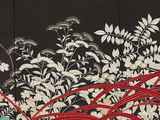 Married women wore kimonos with narrower sleeves. The kurotomesode was their most formal item of clothing. It is always plain black with decoration confined to the base, in this instance a pair of pheasants among autumn plants. Made of thin, loosely woven silk, for wear on warm days in late summer, its autumnal decoration anticipated the coming season. Origin: Japan. Date: 1920 – 1940. Object ID: AK-RAK-2009-3-12.