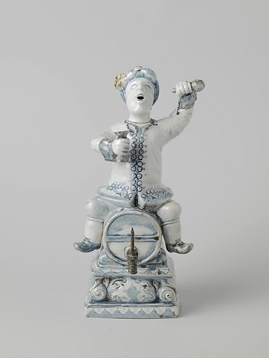 Spirit keg in the shape of a Dutchman sitting astride a barrel. Origin: ? Japan. Date: c 1750. Object ID: AK-NM-9536-A.