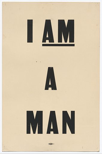 """A white poster with black lettering used by Arthur J Schmidt during the 1968 Memphis March. The poster reads """"I / AM / A MAN."""" A small allied printing label is stamped on the bottom of the front of the poster at center in black ink. The back of the poster is blank. Date: 1960s. Record ID: nmaahc_2017.71.4."""