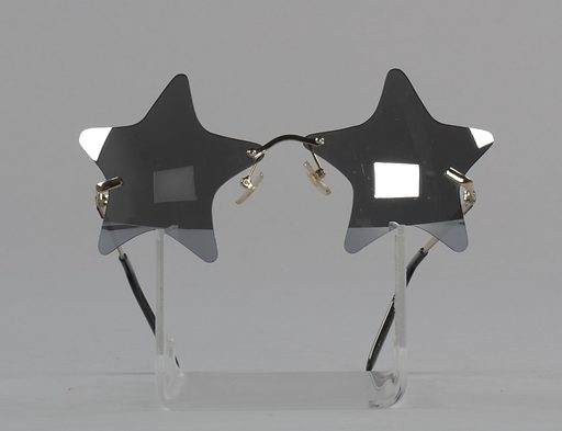"A pair of sunglasses with five-pointed star-shaped mirrored lenses lisensed by Bootsy Collins. The bridge is made of a gold coloured metal and has two (2) clear rubber nosepads attached to it. The arms are made of the same gold coloured metal and the earpieces are made of black plastic. Near the hinge on each exterior arm is raised text reading ""BOOTSY"" with the center of each letter O containing a five-pointed star. The interior of the proper left earpiece has white printed text reading ""Bootzilla makers of those funky thangs to play with"". White text printed on the interior of the proper right earpiece reads ""LS2511 drpeepers.com CHINA"". Date: 2010s. Record ID: nmaahc_2015.234.3."