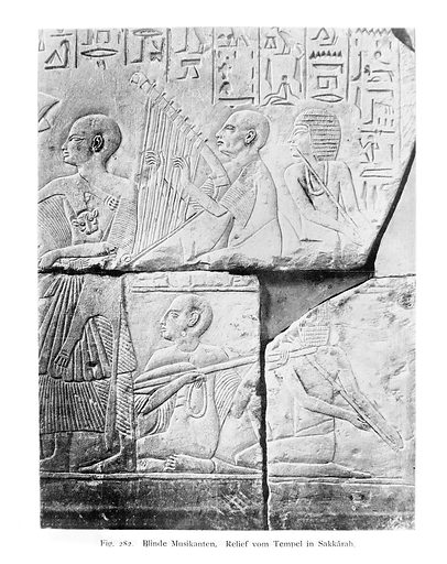 Egyptian wall carving. Wall carving showing blind musicians, scene from Temple of Sakkara, Egypt. Archaeology: Egypt. Egypcian Medicine. Medicine and Art. Work ID: wtmktu8v.