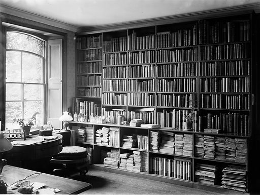 Interior of Charles Darwin study showing wall of books and windows. Down House in Downe, Kent, is where Charles Darwin worked for 40 years and died in 1882. Work ID: edzhz5ma.