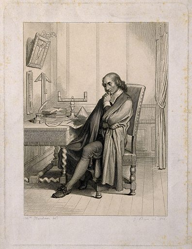 Blaise Pascal, seated at his desk