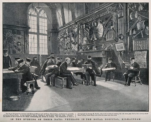 The Royal Hospital, Kilmainham, Ireland: recreation room. Reproduction of a photograph by CHS after GM Roche. Veterans. Soldiers' homes. Medals. Military uniforms. Weapons. Armor. Reading. Contributors: George M Roche. Work ID: jkgkdgzz.