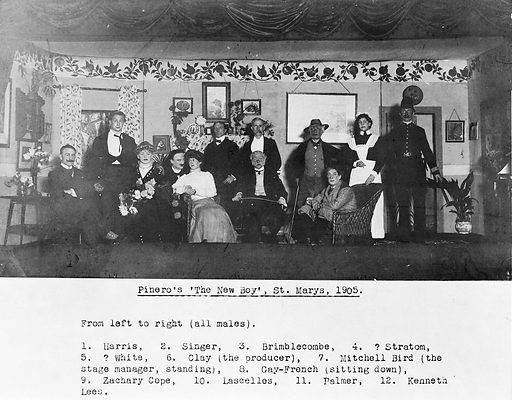 """The cast of a play produced at St Mary's Hospital in 1905. The cast of a play produced at St Mary's Hospital entitled """"The New Boy"""". The names from left to right as follows: 1 Harris, 2 Charles Singer, 3 Brimblecombe, 4 ?Stratous, 5 ?White, 6 Clay, the producer, 7 Mitchell Bird, Stage manager (standing), 8 Gay-French (seated), 9 Zachery Cope, 10 Lascelles, 11 Palmer, 12 Kenneth Lees. Work ID: bqxbkg7w."""