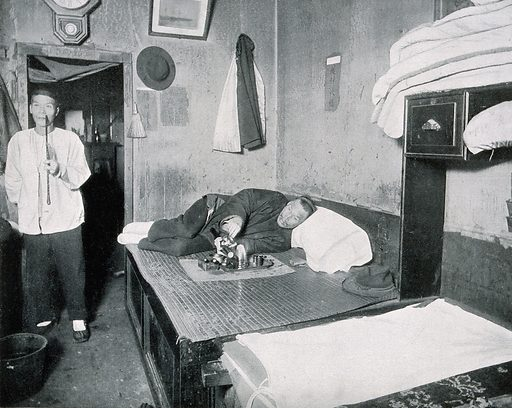 An opium den in San Francisco, early 20th century, with two Chinese men smoking