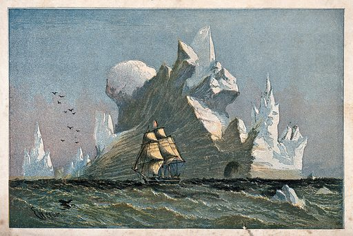 A large iceberg with a ship sailing past it