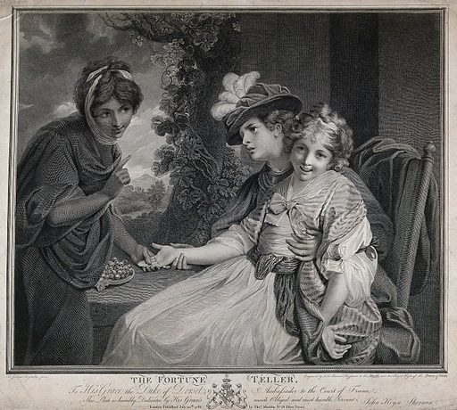 A fortune-teller is reading the palm of a woman with little girl on her lap