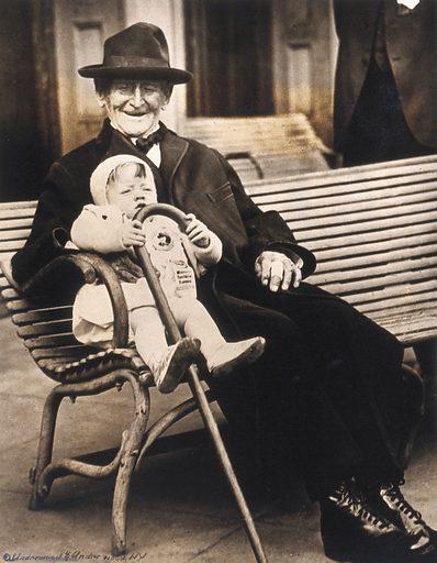 John Daubeny, a centenarian, holding a 1 year old boy
