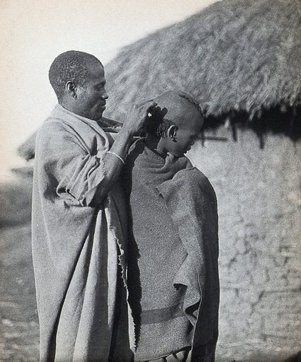 South Africa: a Pondo tribesman attends to the hairstyle of a fellow tribesman. Photograph, ca 1900. Work ID: c6jv4t55.