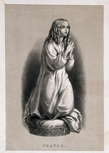 A figure of a young girl with her hands together in prayer