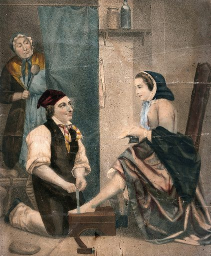 A young woman is sitting on a chair holding a shoe in her hand as she has her feet measured by a man in an apron, they are being watched by a woman in the background who is holding a large spoon. Colour lithograph. Work ID: m7fxc5du.