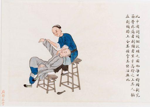Chinese medicine: a practitioner massages a patient's shoulder