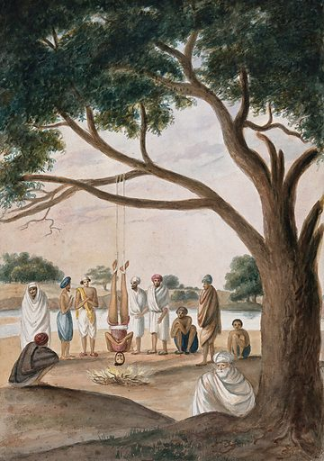 A Hindu ascetic or holy man: suspended upside down over a small fire by cords tied around his ankles. Watercolour, ca 1880 (?). The man is hanging from the branch of a large tree, surrounded by a group of onlookers. Created 1880? (?). Sadhus. Self-torture. Work ID: zmw9se5h.