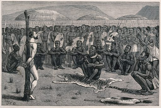 Ernest Grandier, a prisoner of the Zulus, stands naked and tied to a post before the tribe awaiting judgement from the …