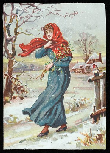 Lady carries mistletoe through the snow