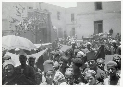 Bani Suef, Egypt: pilgrims at Biba. Photograph by WS Blackman, 192–. Created between 1920 and 1929?. Banī Suwayf (Egypt: Province). Egypt. Contributors: Winifred S Blackman (1872–1950). Work ID: jcvvxzvr.