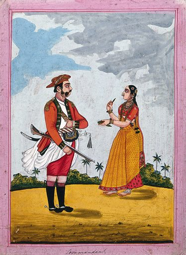 An Indian commandant: his wife handing him some betel leaves. Gouache drawing. Soldiers. Military uniforms. Costume – India. Saris. Caste – India. Swords. Weapons. Armor. Imperialism. Wives. Work ID: u5cyveax.