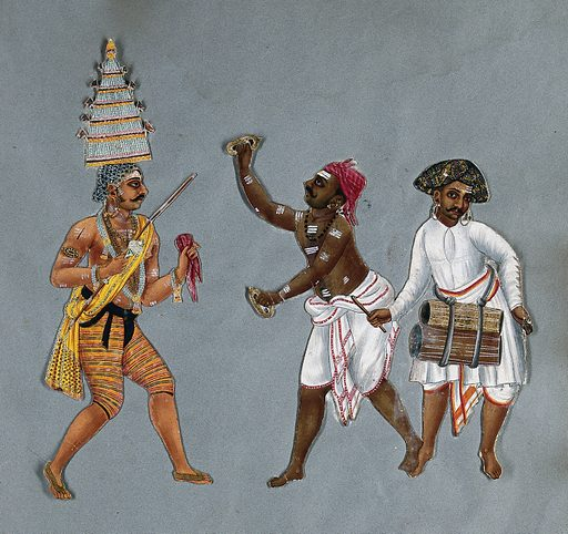 A priest exorcist, with two men playing cymbals and drums. Gouache painting. The priest wears a tall hat resembling a gopuram of a south Indian temple like the Meenakshi Sundareswarar Temple at Madurai, Tamil Nadu. Created 1815?. Exorcism. Musicians. India. Work ID: dy2c5gwj.