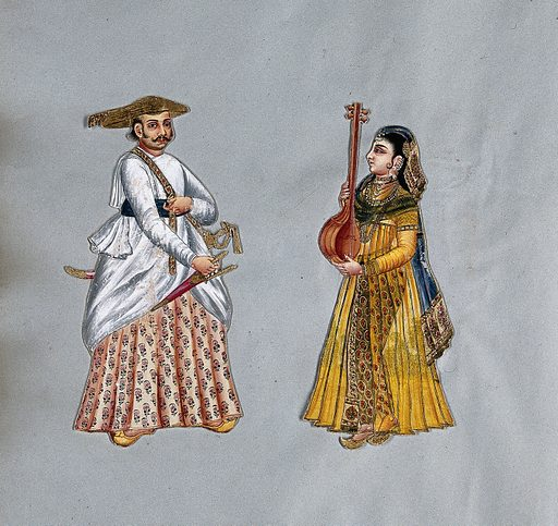 An Indian man and his wife. Gouache painting. Both are richly dressed. The man wears a gold hat and holds a dagger. The woman holds a lute or similar instrument. Created 1815?. India. Work ID: afafdgj9.