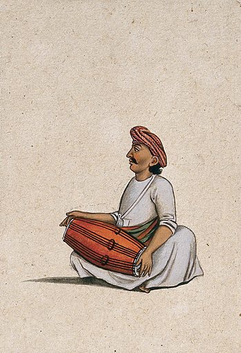A musician playing the dholak (double sided drum). Gouache painting by an Indian artist. Created between 1800 and 1899?. Work ID: xagj86m6.