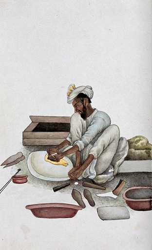 A shoemaker making slippers. Watercolour by an Indian painter. Created between 1800 and 1899?. Work ID: vm8eqxhw.