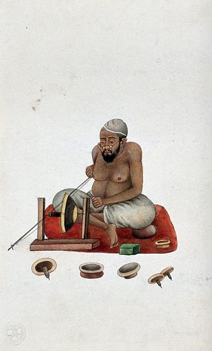 A lapidary at work cutting and polishing stones. Watercolour by an Indian painter. A lapidary often has to work on a small scale, cutting and polishing the stones with great precision. This requires keen eyesight: here the bespectacled craftsman peers over the lathe. Created between 1800 and 1899?. Gem cutting. Eyeglasses. Work ID: nxssd2zc.