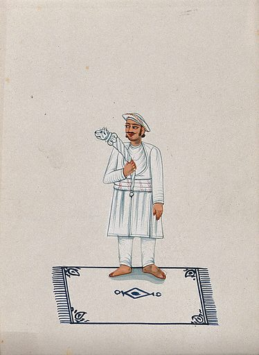 A servant standing on a carpet and holding a stick with a tiger head. Watercolour by an Indian artist. Created between 1800 and 1899?. Work ID: s3jskttx.