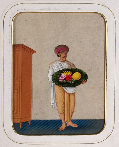 A servant holding a platter of fruit. Gouache painting on mica by an Indian artist. Created between 1800 and 1899?. Work ID: nn4svyd4.