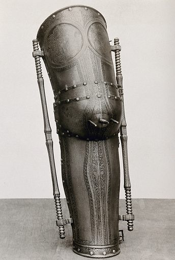 A metal leg covering or prosthesis: decorative with spokes at the knee, housed at the German National Museum, Nürnberg. Photograph by Christof Müller, 1910/1930 (?). Created between 1900 and 1999. Contributors: Christof (Photographer) Müller. Work ID: r68sq8xw.