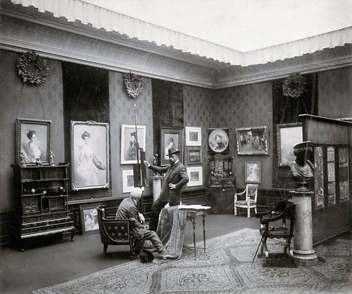 Vienna, Austria: a showroom in which paintings and furniture are displayed, visited by two men. Photograph by J Löwy. Possibly one of the model rooms set up in the Österreichisches Museum für angewandte Kunst, WInterausstellung, 1897? Photographs by Löwy of other such rooms are in the museum (2019). Created 1800–1899. Showrooms – Decoration. Contributors: J Löwy (1835–1902). Work ID: qe8f499w.