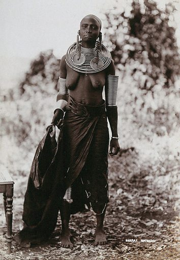 A young Masai tribeswoman, full length, wearing much jewellery. Photograph, ca1900. Work ID: xprhwhjk.