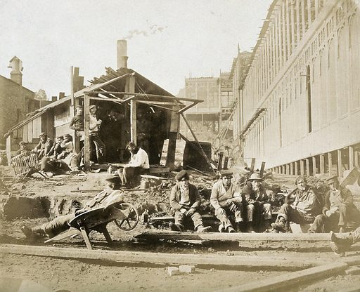 The Crystal Palace during its re-erection at Sydenham, London: construction workers taking a break on site. Photograph by Philip Delamotte, ca 1854. Created 1854. Contributors: Philip H Delamotte (1821–1889). Work ID: mjka5kg2.