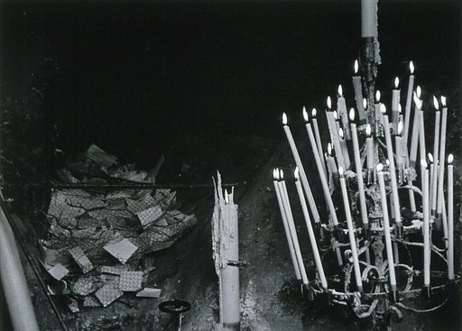 Lourdes, France: the Grotto of Our Lady of Lourdes: petitions to the Virgin Mary placed in a hollow at the shrine. Photograph, ca 1937. Created 1937. Work ID: v3dne289.