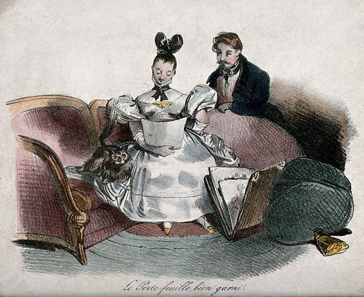 A seated woman studying a drawing with a man at her side. Lithograph. Work ID: f63qw9cg.