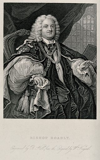 Benjamin Hoadly, Bishop of Winchester. Steel engraving by B Holl after W Hogarth. Hoadly's hand is raised as if in a blessing, a draped curtain and a stained glass window behind him, he is wearing the robes of Chancellor of the Garter. Contributors: William Hogarth (1697–1764); Benjamin Holl (1808–1884). Work ID: mb82wvmt.