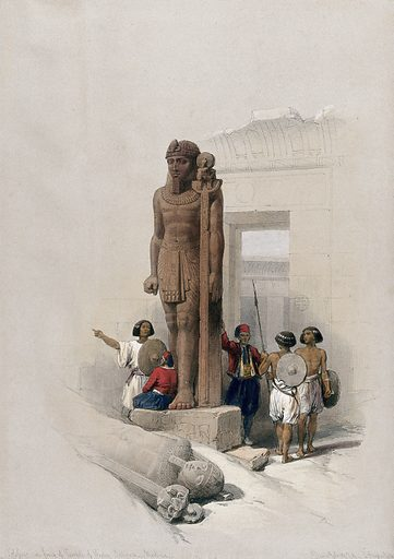 Statue at the temple at Wadi Saboua, Egypt. Coloured lithograph by Louis Haghe after David Roberts, 1849. Created 1849. Antiquities. Egyptian. Architecture. Contributors: David Roberts (1796–1864); Louis Haghe (1806–1885). Work ID: zfa8bbqu.