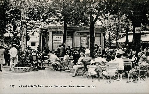 People sitting oudoors near the Source des Deux Reines, in Aix-les-Bains, France. Photographic postcard, ca 1920. Created 1920?. Work ID: nxjb254m.