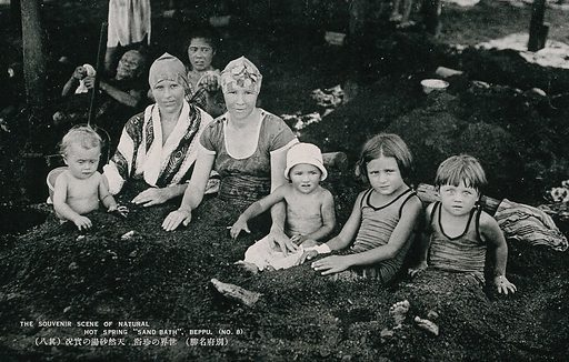Occidental women and children lying under the sand of the hot sping at Beppu, Japan. Photographic postcard, ca 1930. Created 1930?. Work ID: k6krpffx.