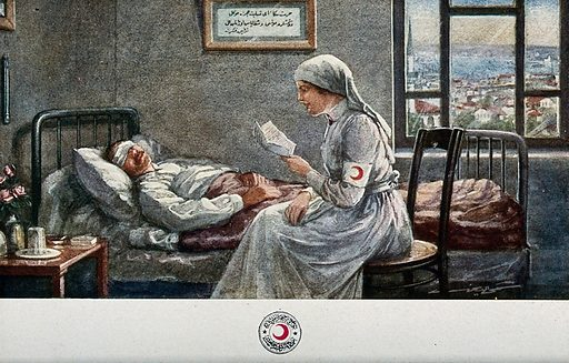A nurse is sitting at the bedside of a wounded man with a bandage over his eyes; she is reading him a letter. Photographic postcard, ca 1930. Created 1930?. Work ID: xakfxw9a.