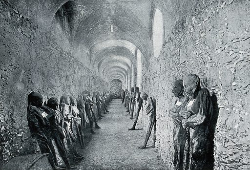 Corpses standing against the walls of catacombs at Guanajuato, Mexico. Process print after CC Pierce & Co Guanajuato (Mexico). Contributors: C C Pierce (1861–1946). Work ID: wxw9xf32.