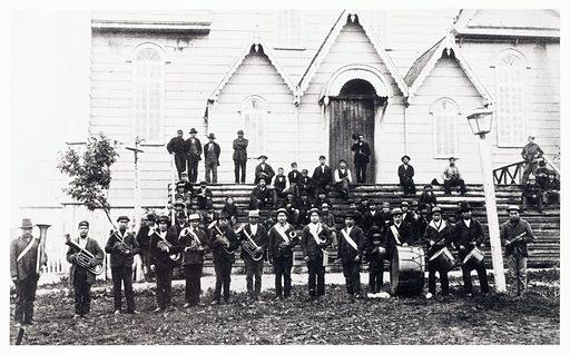 Tsimshian brass band, Metlakahtla. Tsimshian brass band, in front of Metlakahtla BC Church. American Indian. Work ID: uss5gs8g.