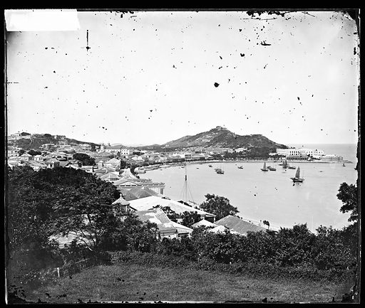 Macao, China. Photograph by John Thomson, 1870. Throughout the 19th century Praia Grande was the most fashionable address in Macau. It had captured the imagination of a number of artists and photographers and, from the 1820s onwards, a view of the Praia Grande was the souvenir of Macau par excellence. Both of the well-known painters George Chinnery and Lamqua were residents of Macau at the time, and the view of the Praia Grande was one of their favourite subjects. In 1844 Jules Itier, the head of the French trade commission in China, made the first photograph of this famous view in the form of a daguerreotype. In 1870, when John Thomson took this photograph, he selected a view looking down on the Praia Grande from Penha Hill above Bishops Bay. In the 20th century the area around Praia Grande underwent remarkable redevelopment, and it is no longer possible to see the famous view of picturesque Praia Grande except in old paintings, photographs and postcards. Contributors: J Thomson. Work ID: nvyp6sfa.
