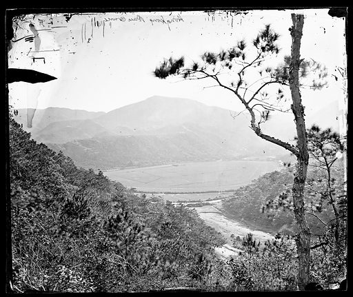 Racecourse, Happy Valley, Hong Kong. Photograph by John Thomson, 1868/1871. Viewed from the hill. The village of Wong Nei Cheong can just be seen at the far end of the racecourse. Contributors: J Thomson. Work ID: vw3h2xtj.